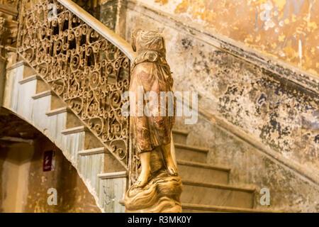 Cuba, Havana. Headless statue and staircase at entry to La Guarida Restaurant. Credit as: Wendy Kaveney / Jaynes Gallery / DanitaDelimont.com - Stock Image