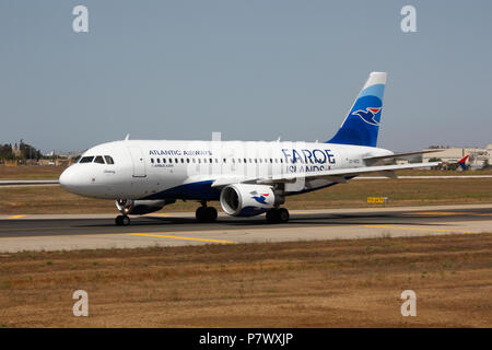 Airbus A319 commercial passenger jet plane belonging to Atlantic Airways, the airline of the Faroe Islands, taxiing for departure - Stock Image