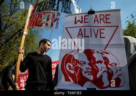 Participants Monstration rally ( a public creative and fun performance) during marking International Workers' Day celebration in central Moscow - Stock Image