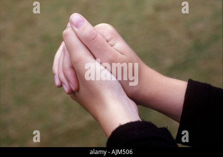 Hands of a girl put together - Stock Image