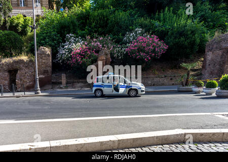 Rome, Italy - 24 June 2018: police (polizia) car at the entrance of the Great Roman Colosseum (Coliseum, Colosseo), also known as the Flavian Amphithe - Stock Image