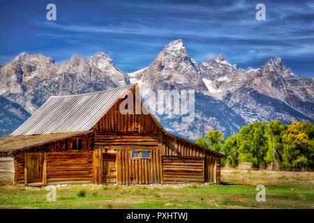 Barn and Teton Mountains with fall color. Grand Teton National Park, WY - Stock Image