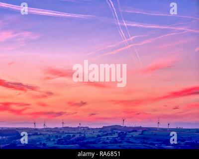 Wirksworth, Derbyshire, UK. 1st January, 2019. UK Weather: spectacular first sunset of 2019 wind turbines near Brassington / Wirksworth Derbyshire Credit: Doug Blane/Alamy Live News - Stock Image