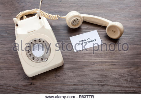 Retro telephone with note - Book An Appointment - Stock Image