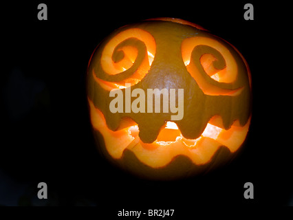 Halloween pumpkin against black background - Stock Image