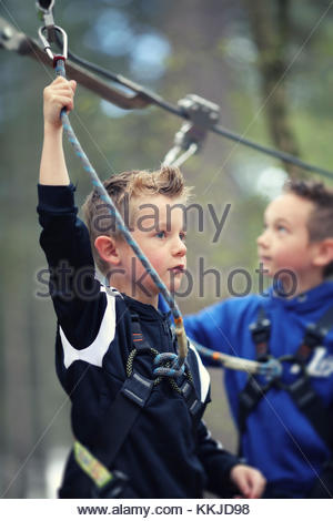 boys on zip wire - Stock Image