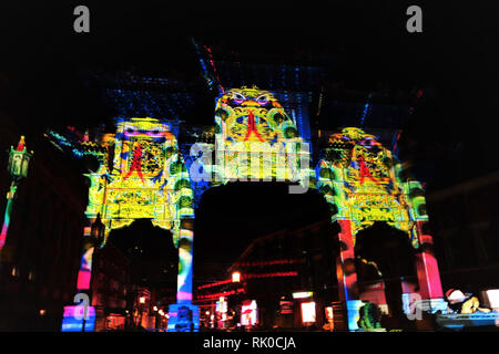 Liverpool, UK. 8th Feb 2019. The first of three nights of light projections and fireworks took place by the Chinese Arch on Friday evening, February 8. The light show was to celebrate the Chinese New Year of the pig, together with the 20th anniiversary of the Twinning between Shanghai and Liverpool and of the gifting of the Chinese Arch to Liverpool. The story follows Jingwei and her friend Piggy as they travel to the west. Credit: Pak Hung Chan/Alamy Live News - Stock Image