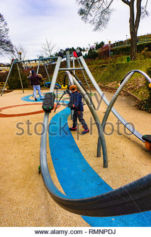 Poznan, Poland - February 10, 2019: Young boy playing on a modern skate equipment at a new playground on the Malta park on a cloudy day. - Stock Image