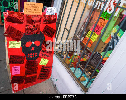 A hand made sign outside a curiosity shop. - Stock Image