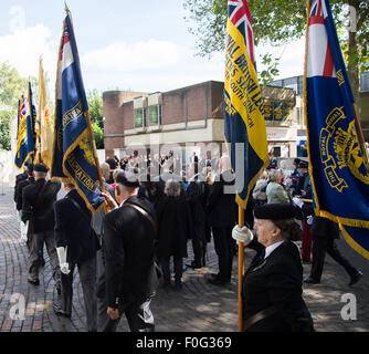 Portsmouth, UK. 15th Aug, 2015. Standard bearers parade to the memorial during the VJ Day 70th anniversary at the - Stock Image