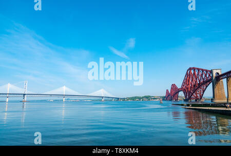 South Queensferry, Scotland, United Kingdom, 15 May 2019. UK Weather: Gorgeous sunny warm day along the Firth of Forth coast at with a viuew of the three bridges. Credit: Sally Anderson/Alamy Live News - Stock Image