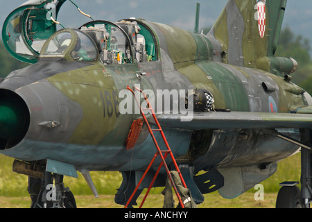 Croatian Air Force MiG-21 UMD '166' two-seater trainer closeup, cockpit opened and flying helmet lying on - Stock Image