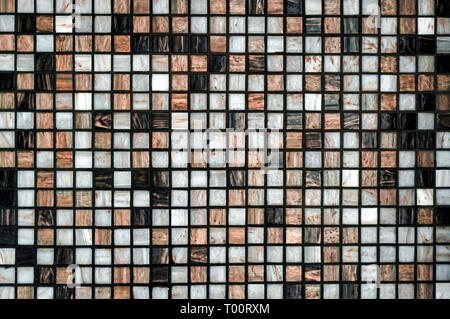 Abstract background tiles in a mosaic decorate wall - Stock Image
