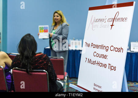 Miami Beach Miami Florida Beach Convention Center Women's Conference seminar meeting Hispanic woman women audience speaker publi - Stock Image