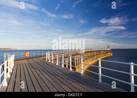 The West Pier at Whitby at sunrise. - Stock Image