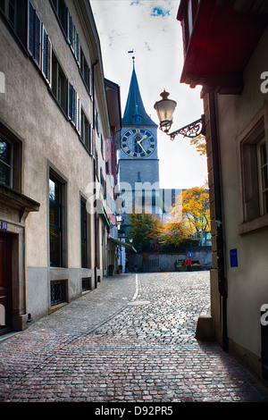 Street View in Zurich Old Town with the St Peter's Church, Switzerland - Stock Image