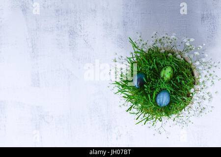 Eggs with flowers on a white background. Easter Symbols. - Stock Image
