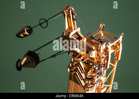 View looking down onto top of crane with backdrop of deep green sea - Stock Image