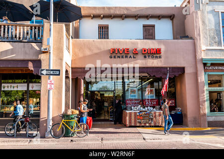 Santa Fe, USA - June 14, 2019: Shops on old town street in United States New Mexico city with adobe style architecture - Stock Image