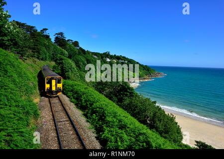 Local train heading towards St Ives,passing Carbis Bay,Cornwall,England,UK - Stock Image