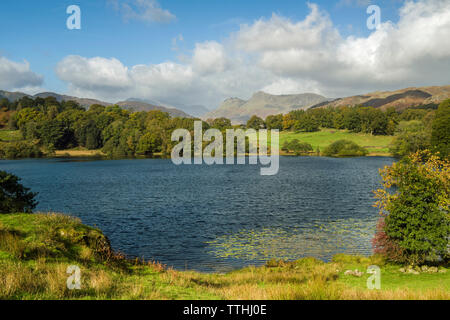Loughrigg Tarn in the Lake District National Park, Cumbria on an October day. - Stock Image