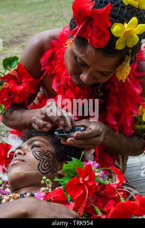 Demonstration of traditional Facial Tattoo, Tufi, Oro Province, Papua New Guinea - Stock Image
