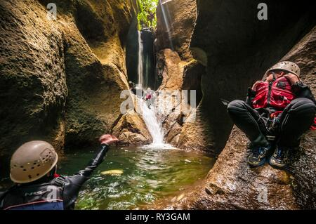 Central America, Caribbean, Lesser Antilles, Dominica island, canyoning on the Roseau River - Stock Image