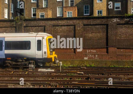 A South Eastern train leaves London's Victoria station - Stock Image