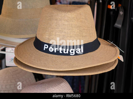 A Straw Panama Style Souvenir Sun Hat For Sale With Portugal On The Front Display In A Tourist Shop Albufeira Portugal - Stock Image