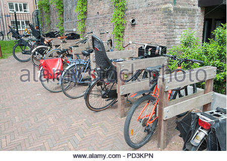 Design element - wooden cycle racks. With lots of spaces to put the locks through to ensure the bike is locked to something immoveable - especially im - Stock Image