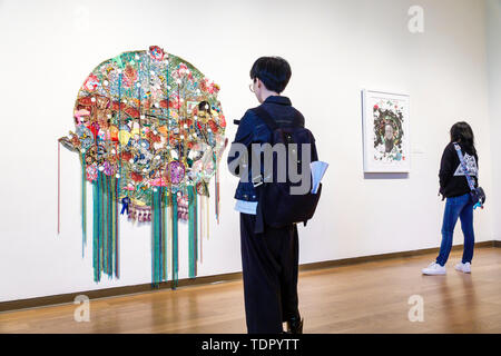 Orlando Florida Museum of Art inside gallery exhibit contemporary Asian man woman looking - Stock Image