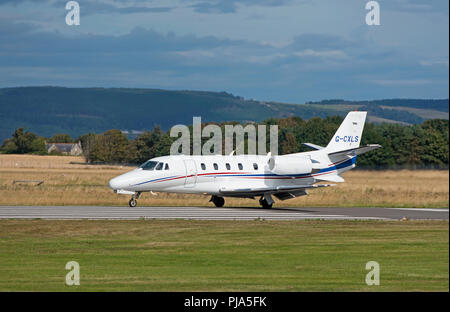 A uk Registered Cessna Citation XLS G-OXLS arriving at Inverness airport in the Scottish Highlands. - Stock Image