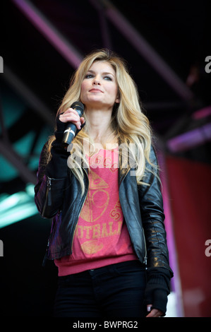Model Marisa Miller speaks to football fans at the NFL rally at Trafalgar Square, London on October 30, 2010, in - Stock Image