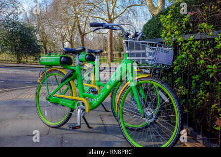 A Lime E electric bike stands on the pavement in Primrose Hill, London in February 2019. - Stock Image