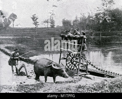 Halftone illustration of Chinese waterwheel used for irrigating rice crops, circa 1900. From an original image in - Stock Image