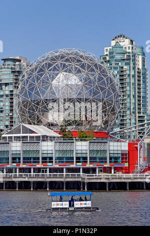 Aquabus ferry sailing past the Telus World of Science geodesic dome on False Creek, Vancouver, BC, Canada - Stock Image