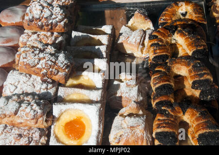 Pastries displayed in the window of a cafe in the Melbourne suburb of Elsternwick, Australia - Stock Image