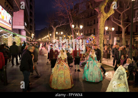 Women in traditional Spanish Costume taking part in the Fallas procession marking the start of spring in Gandia - Stock Image