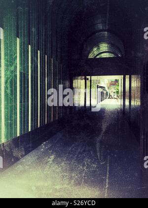 Grunge atmospheric dark arched passageway - Stock Image