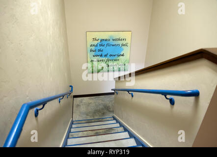 Church stairwell with a Bible verse from the Old Testament book of Isaiah  posted on wall. - Stock Image