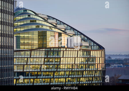 Dawn first light Manchester One Angel Square the Co-operative Group headquarters green office building - Stock Image