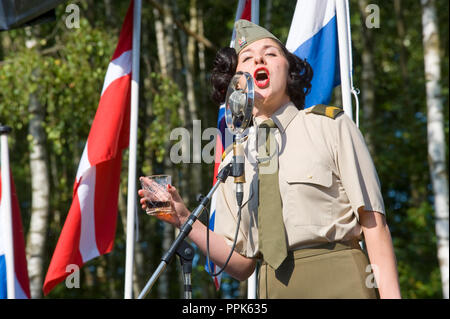 ENSCHEDE, THE NETHERLANDS - 01 SEPT, 2018: A singer from 'Sgt. Wilson's army show 'doing their stage act with historic forties songs during a military - Stock Image