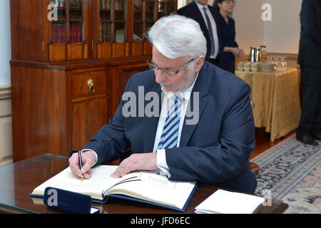 Polish Foreign Minister Witold Waszczykowski signs U.S. Secretary of State Rex Tillerson's guestbook before - Stock Image
