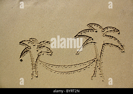 Drawing of two palm trees and hammock in wet sand. Please see my collection for more similar photos. - Stock Image