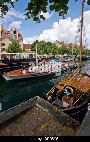 Sightseeing boat in Christianshavn canal, Copenhagen, Denmark, Europe - Stock Image