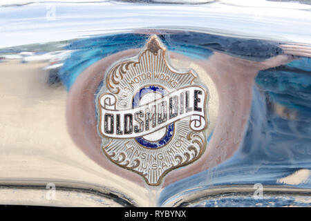 Oldsmobile badge on the radiator of a 1927 car. - Stock Image