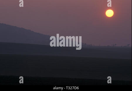 full moon and sunset over fields, Afton Down, West Wight, Isle of Wight, England - Stock Image