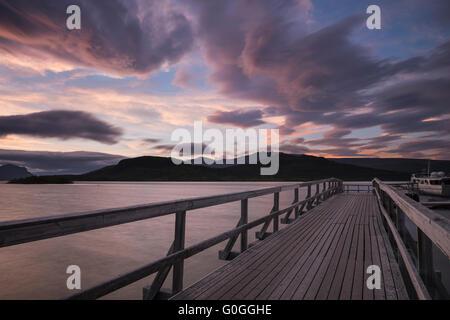 Sunset over pier at Saltoluokta Fjällstation, Kungsleden trail, Lapland, Sweden - Stock Image
