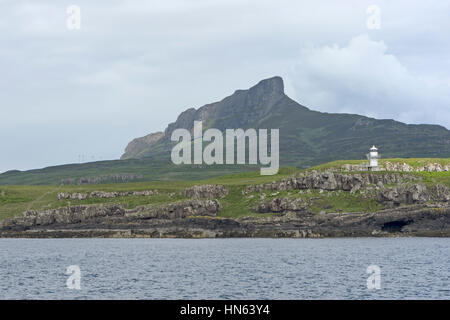 Isle of Eigg and the Sgurr, and lighthouse on Eilean Chathastail. June 2014. - Stock Image