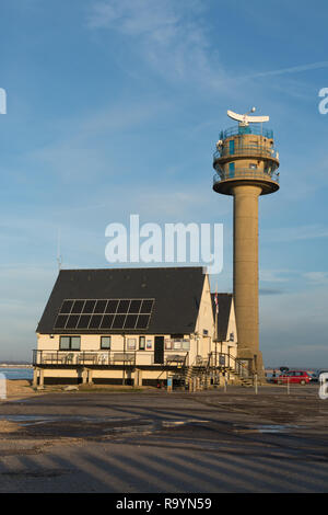 RNLI Lifeboat Station and Coastguard Tower at Calshot on the Solent in Hampshire, UK - Stock Image
